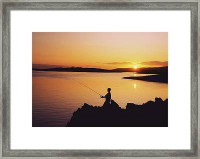 Fishing At Sunset, Roaring Water Bay Framed Print by The Irish Image Collection