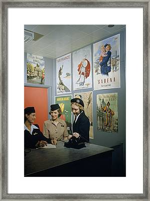 Flight Attendants Stand And Talk Framed Print by B. Anthony Stewart