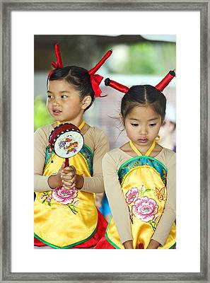 Flower Drum Dancers Framed Print by Terry Finegan