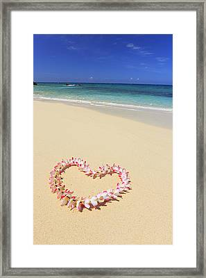 Flowers Placed In The Shape Of A Heart On Beach Framed Print by Imagewerks