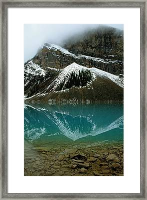 Fog Has Lifted From Lake Louise Framed Print by Raymond Gehman