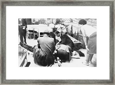 Followers Of Malcolm X Kneel By The Framed Print by Everett