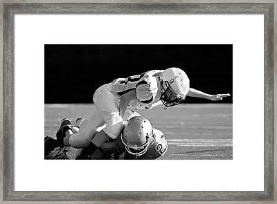 Football In Black And White Framed Print by Susan Leggett