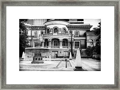 Fountain In The Pool Framed Print by John Rizzuto