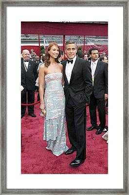 George Clooney, Sarah Larson Wearing Framed Print by Everett