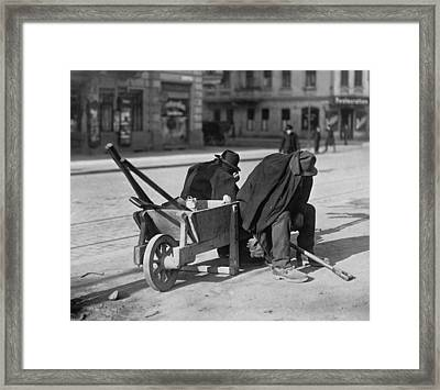 German Street Sweepers Taking Lunchtime Framed Print by Everett