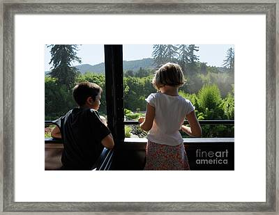 Girl And Boy Looking Out Of Train Window Framed Print by Sami Sarkis