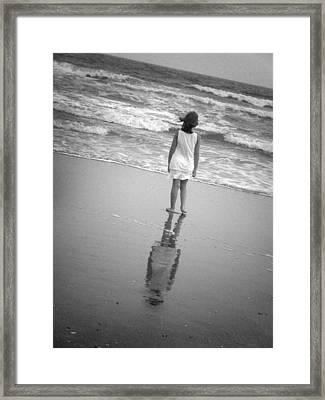 Girl By Ocean Framed Print by Kelly Hazel