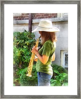 Girl Playing Saxophone Framed Print by Susan Savad