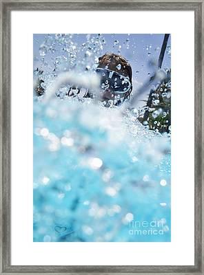 Girl Splashing Water In Swimming Pool Framed Print by Sami Sarkis