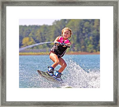Girl Trick Skiing Framed Print by Susan Leggett