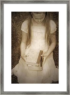 Girl With Books Framed Print by Joana Kruse