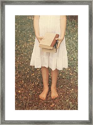 Girl With Old Books Framed Print by Joana Kruse