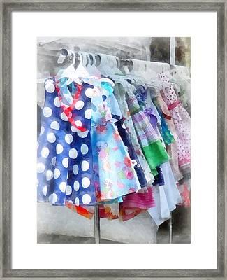 Girl's Dresses At Street Fair Framed Print by Susan Savad