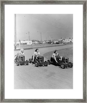 Go Go Cart Girls Framed Print by General Photographic Agency