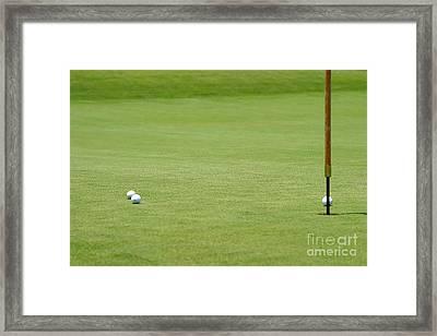 Golf Balls Near Flagstick Framed Print by Henrik Lehnerer