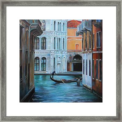 Gondolier In Venice Framed Print by Emily Olson