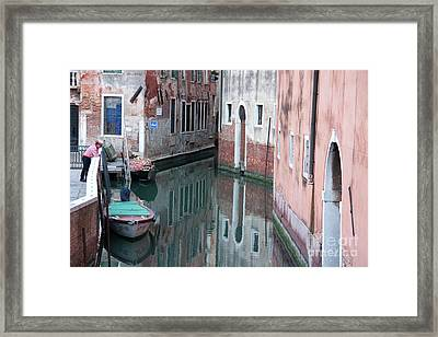 Gondolier Overlooking Rio De S. Anzolo Venice Italy Framed Print by Julia Hiebaum