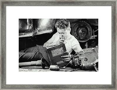 Greasy Mechanic On Garage Floor, Manual Framed Print by Archive Holdings Inc.