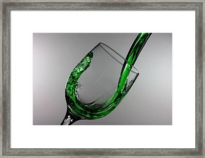 Green Juice Splashing From A Wine Glass Framed Print by Paul Ge
