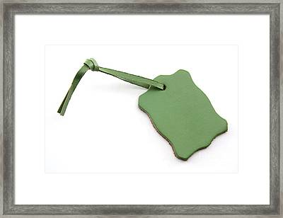 Green Tag Leather Label Framed Print by Blink Images