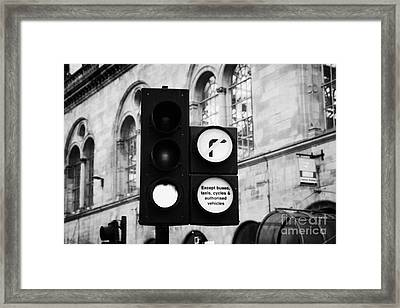 Green Traffic Light Signal With No Right Turn Except Buses Taxis Cycles And Authorised Vehicles Glas Framed Print by Joe Fox