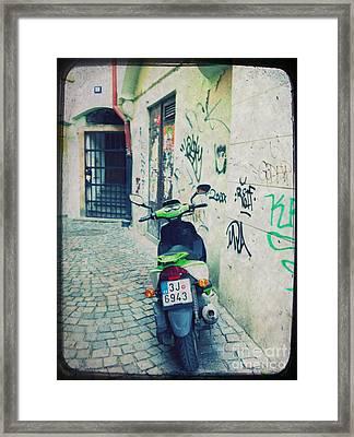 Green Vespa In Prague Framed Print by Linda Woods
