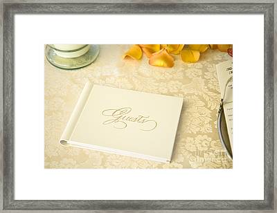 Guestbook On A Table Framed Print by Ned Frisk