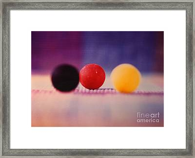 Gumballs On Placemat Framed Print by Christine Perry
