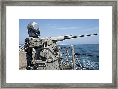 Gunners Mate Aims A 25mm Chain Gun Framed Print by Stocktrek Images