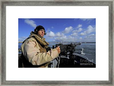 Gunners Mate Mans An M2 Hb .50-caliber Framed Print by Stocktrek Images