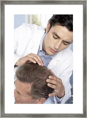 Hair Transplant Consultation Framed Print by Adam Gault