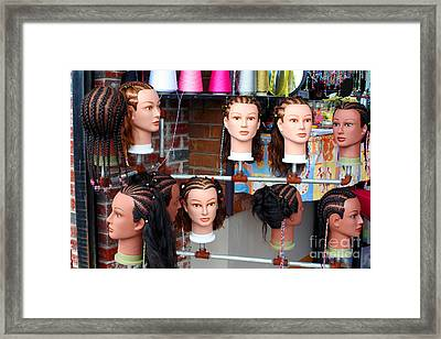 Hairstyles On Mannequins Framed Print by Susan Stevenson