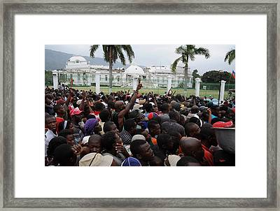 Haitians Gathers For Food Distribution Framed Print by Everett