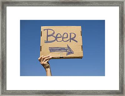 Hand Holding Up Makeshift 'beer' Sign Framed Print by Pete Starman