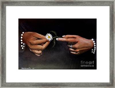 Hands And Daisy Framed Print by Kostas Koutsoukanidis