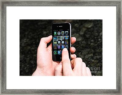 Hands Holding An Iphone Framed Print by Photo Researchers, Inc.