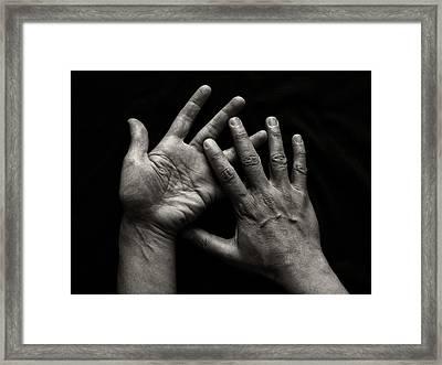 Hands On Black Background Framed Print by Luigi Masella