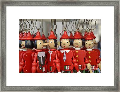 Hanging Pinocchios Puppets Framed Print by Sami Sarkis