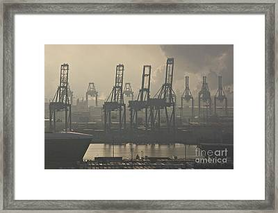 Harbor Cranes Framed Print by Sean Griffin