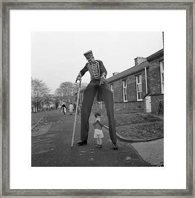 Henry The Stilt Man Framed Print by John Drysdale