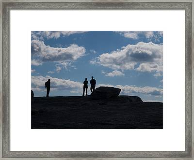 Hikers On Cliff Top Framed Print by Jim DeLillo