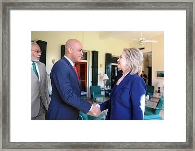 Hillary Clinton Meets With Haitian Framed Print by Everett