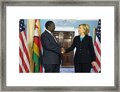 Hillary Clinton Shakes Hands Framed Print by Everett