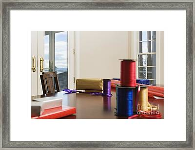 Holiday Ribbon On Table Framed Print by Andersen Ross