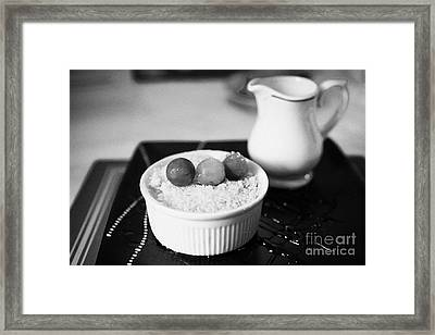 Home Made Apple Crumble Dessert With Grapes Served In A Gastro Pub Scotland Uk Framed Print by Joe Fox