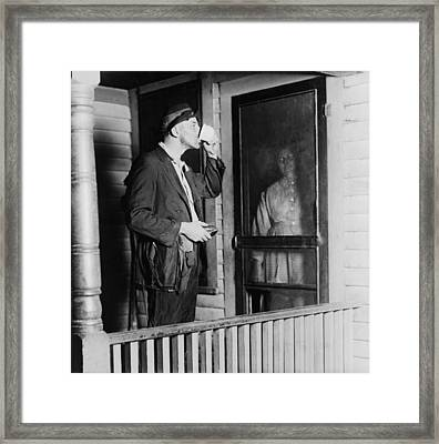 Homeless Man In Ragged Clothes Eating Framed Print by Everett