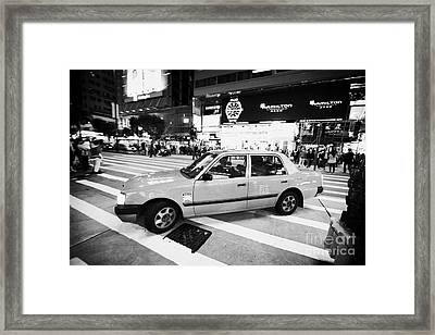 Hong Kong Red Taxi At Night On Nathan Road Downtown Kowloon Hong Kong Hksar China Framed Print by Joe Fox