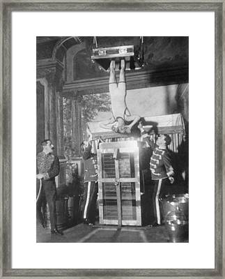 Houdinis Water Torture Cell Escape Framed Print by Everett
