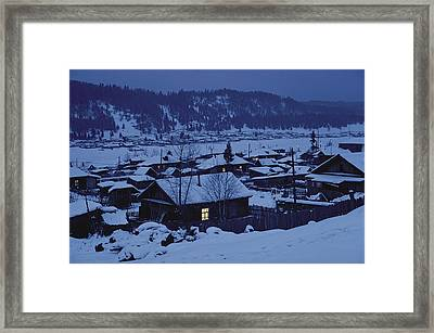 Houses In The Snow At Dusk Framed Print by Dean Conger